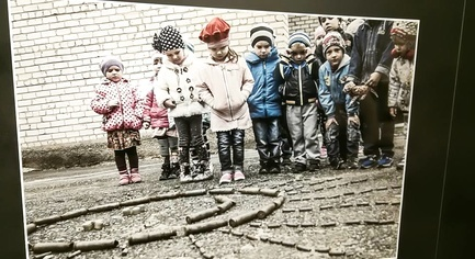 "PHOTOS. ""We Are Alive"": A Photo Exhibition of Children from the Frontline Zone Opened In Kiev"